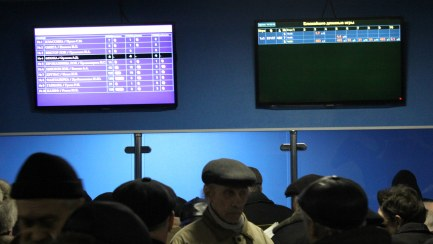 Gamblers in the betting shop in the grandstand.