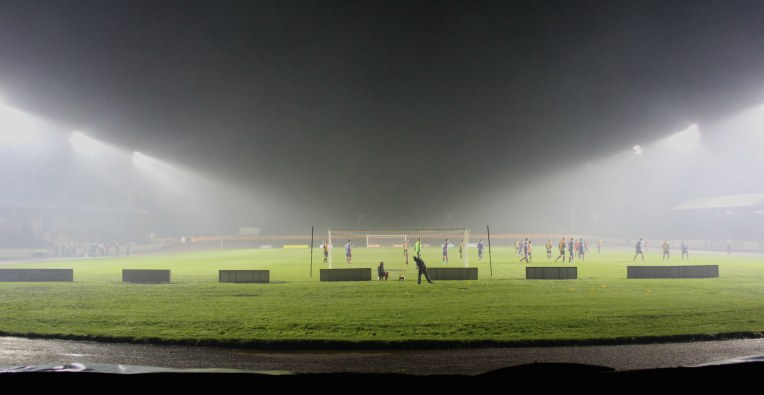 Floodlights shine through the mist at Shielfield Park