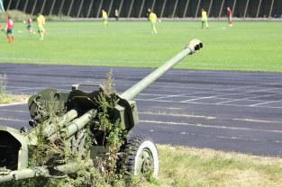 An overgrown artillery cannon overlooks the field at Moscow's Izmailovo Stadium