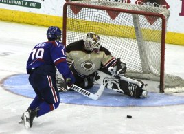 Brown goalie Tim Ernst denies C.J. Smith of UMass Lowell in the shoot-out.