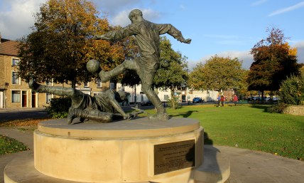 A sculpture commemorating West Auckland's 1909 Thomas Lipton Trophy win in Turin.