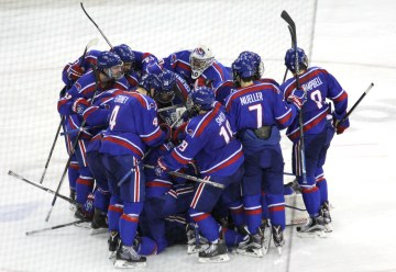 UMass Lowell's players celebrate winning the 2015 Belpot Trophy.