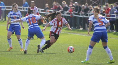 Action as Sunderland (red and white) take on Reading in the FA Women's Cup.