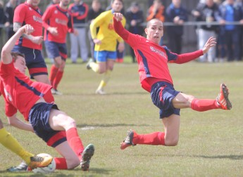 Redcar defender Kristian Kamara throws himself in the path of a Stockton attack during the Wearside League Cup Final.