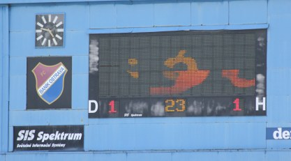 The misfiring scoreboard struggles with a 'Gol!' animation.