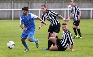 Action as Ashington (stripes) take on Nelson the FA Cup extra-preliminary round.