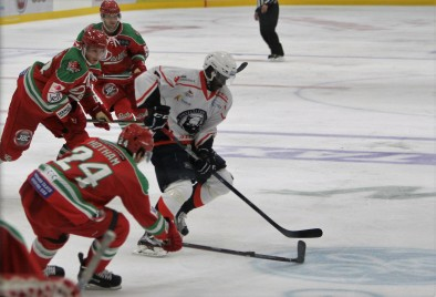Medvescak's Edwin Hedberg (white jersey) tries to evade Cardiff D-man Andrew Hotham.