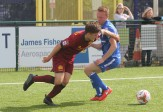 Action as Airbus UK (blue) take on Cardiff Met in the Welsh Premier League.