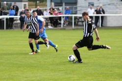 Action as Ashington (stripes) take on Nelson the FA Cup extra-preliminary round.