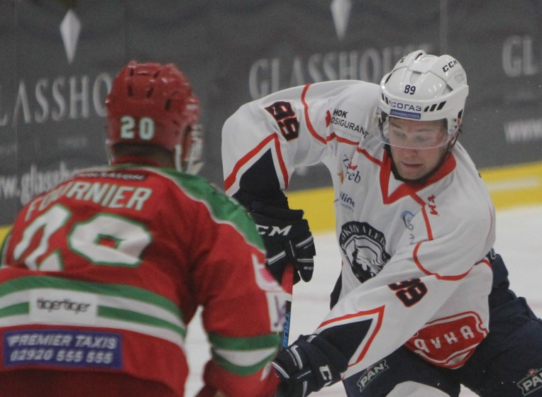 Mark Katic of Medvescak (white) takes on Gleason Fournier of Cardiff Devils.