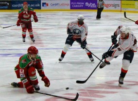 Medvescak's Mark Katic (white) fires in a shot on goal.