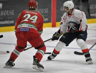 Action as Cardiff Devils (red) take on Medvescak Zagreb.