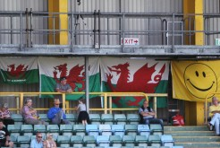 Welsh flags hanging in the main stand at Jenner Park, Barry.