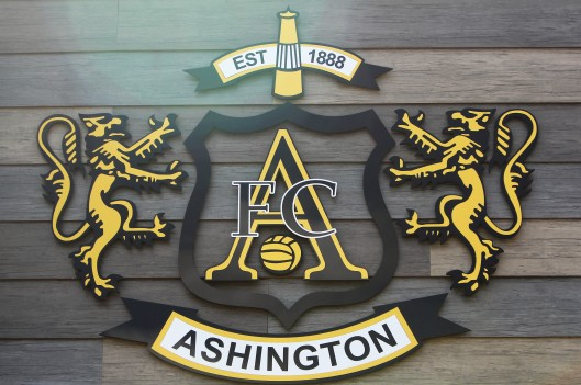 Pit lamps and lions on Ashington's club crest.