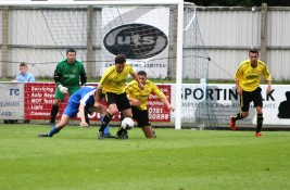 Action as Dunston UTS (blue) take on Skelmersdale Utd in the FA Cup.