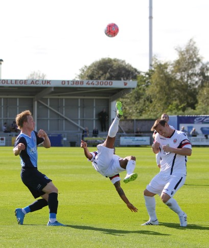 Acrobatic action as Bishop Auckland (blue) take on Trafford in the FA Cup.