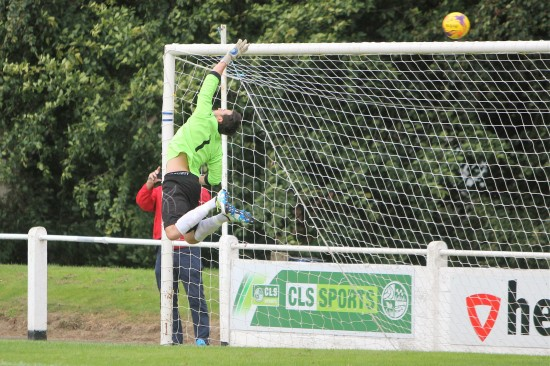 Bridlington Town's goalie makes a flying save at Guisborough.
