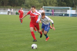 Action as Penrith (white) take on Dunston UTS in the FA Cup.