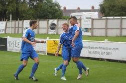 Dunston's players celebrate with opening goalscorer Liam Threar (right).