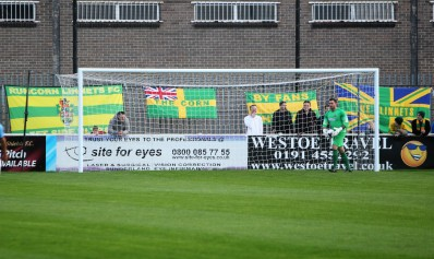 Runcorn banners flying behind the goal.