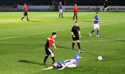A sliding tackle dispossesses Ryton's substitute Michael Henry.