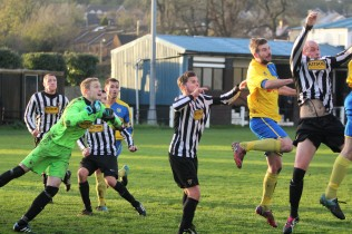 Action as Alnwick Town (stripes) take on Stockton Town in Northern League Division 2.