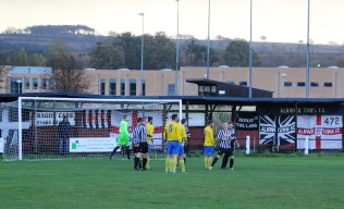 Flags behind one goal at St. James' Park, Alnwick.