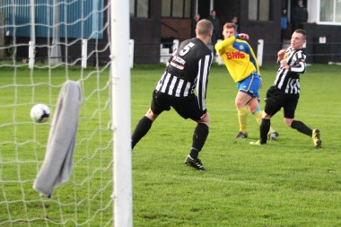 Kallum Hannah (yellow) fires in the opening goal for Stockton at Alnwick Town.