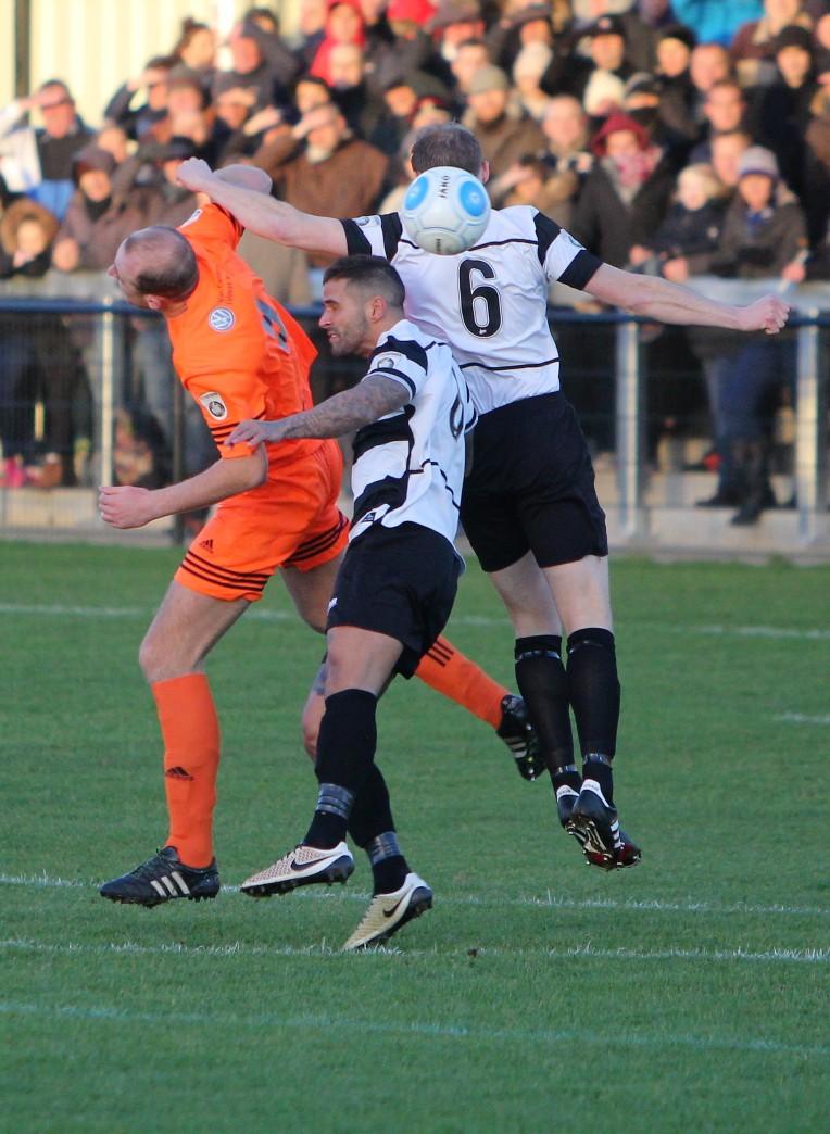 Darlington's Gary Brown (number 6) and Leon Scott challenge Halifax's Tom Denton.