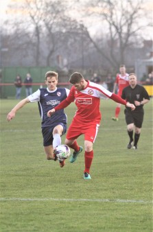 Action as North Shields (red) take on Shildon in the FA Vase Third Round