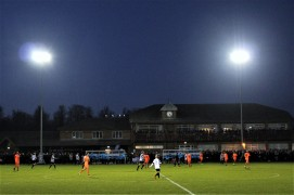 The clubhouse at Blackwell Meadows under the floodlights.