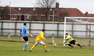 Billingham Town goalie Thomas Dawson saves from Cleethorpes Town forward Brody Robertson.