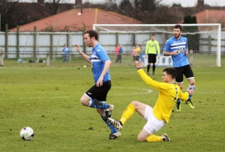 Action as Billingham Town (blue) take on Cleethorpes Town in the FA Vase 5th round.