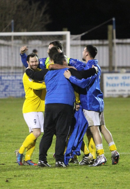 Cleethorpes Town players and staff celebrate after winning their FA Vase 5th Round tie at Billingham Town.