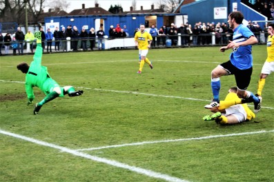 Cleethorpes goalie Liam Higton denies Billingham's Jamie Davis during the teams' FA Vase 5th round tie.