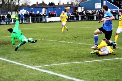 Cleethorpes goalie Liam Higton denies Billingham's Jamie Davis during the teams' FA Vase 5th round tie.
