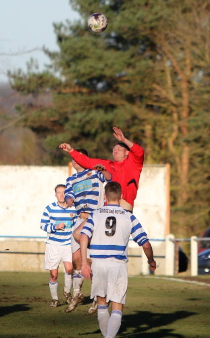 An aerial tussle in the game between Chester-le-Street (hoops) and West Allotment Celtic.