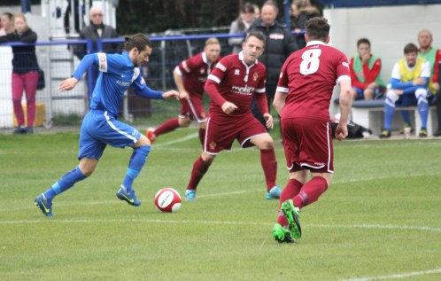 Action from the FA Trophy game between Glossop North End (blue) and Spennymoor Town.
