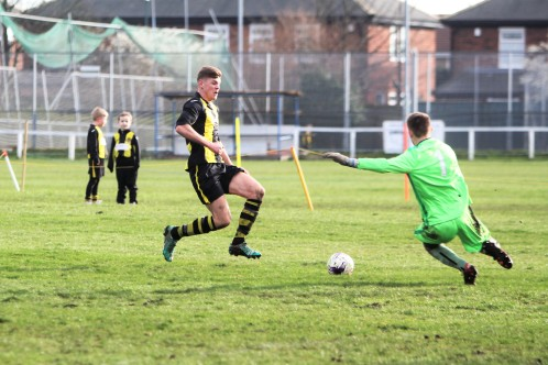 Jason Blackburn (stripes) goes close for Hebburn Town at home to Tow Law Town.