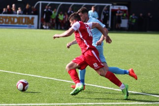 Action as Scarborough Athletic (red) take on Marske United in the FA Cup Preliminary Round.