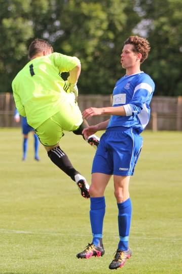 Action as Jarrow (blue) take on Easington in Northern League Division Two.