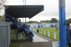 A cup tie crowd shelters from the rain at Newcastle Benfield.
