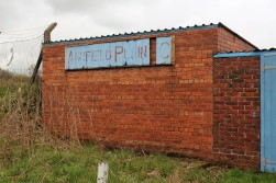 Faded paintwork on an old Annfield Plain AFC sign.
