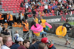 Stewards clear away inflatables during the FC Kobenhavn vs Midtjylland game.