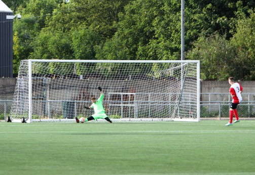Durham United goalie Aaron Hinds makes a crucial save in the penalty shoot-out.