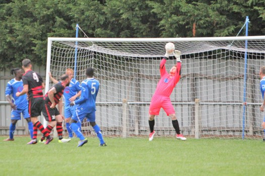 Wolviston's goalie makes a save in a pre-season friendly against Durham City.