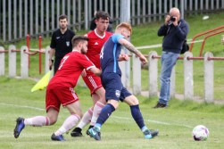 Action as Brandon Utd (red) take on Washington in the FA Vase.