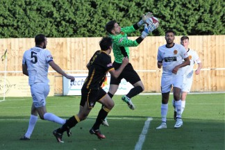 Belper Town goalie Leigh Overton claims the ball against Morpeth Town.