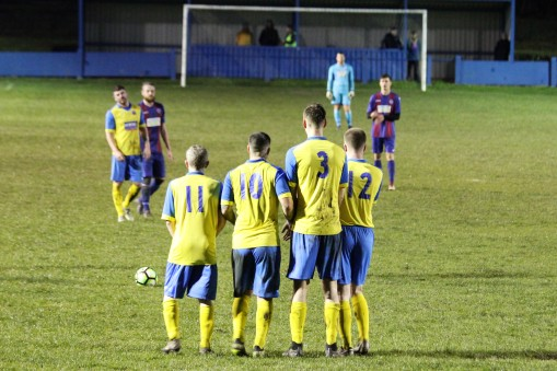 Durham City's wall lines up to defend a Heaton Stannington free kick.