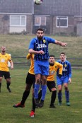 Action as Crook Town (amber and black) take on Ryton in Northern League Division 2.